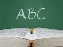 ABC. Written on a chalkboard with an open book and a pencil on foreground stock photos