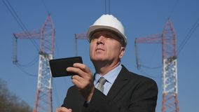 Energy Industry Engineer Use Cell Phone Working in Maintenance Activity stock photography