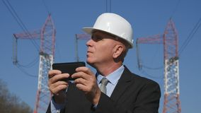 Energy Working in Energetic Industry Using Mobile in Maintenance Work royalty free stock photo