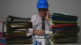 Engineer in Technical Archive Talking to Mobile Phone royalty free stock photography