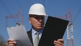 Engineer Working in Energetic Industry Use Agenda Check Maintenance Documents royalty free stock photo