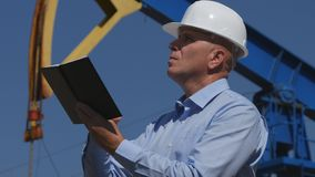 Petroleum Engineer Working in Extracting Oil Industry Use Agenda In Maintenance.  royalty free stock photo