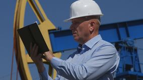 Petroleum Engineer Working in Extracting Oil Industry Using Agenda.  royalty free stock images