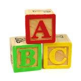 abc-alfabetet blockerar träungar Arkivbilder