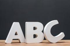 Abc-alfabetet märker framme av svart tavla Royaltyfria Bilder