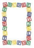 ABC Alphabet Block Frame. Wooden alphabet blocks arranged to create a frame on a white background royalty free illustration
