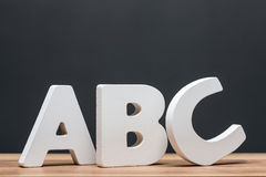 Abc alphabet letters in front of blackboard Royalty Free Stock Images