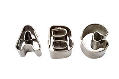 Abc baking tins. Letters a b c baking tins isolated on white Stock Images