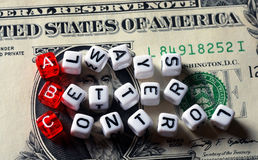 ABC Always Better Control on dollar banknote. ABC - Always Better Control acronym dices on dollar bill Royalty Free Stock Images