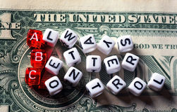 ABC Always Better Control on dollar banknote. ABC - Always Better Control acronym dices on dollar bill Stock Photo