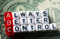 ABC Always Better Control on dollar banknote. ABC - Always Better Control acronym dices on dollar bill Royalty Free Stock Photo
