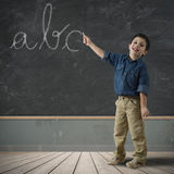 Abc in blackboard. Child writing abc in a blackboard Royalty Free Stock Photography