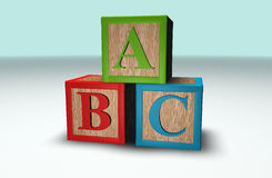 Abc blocks. Wooden 3d Abc blocks stacked in a pile Stock Photo