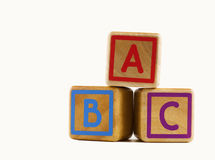 Wooden cubes marked A, B and C. Three wooden blocks , one marked with a red letter 'A' , another marked with a blue letter 'B' and a third one marked with a royalty free stock photography