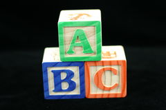 ABC blocks. ABC wood blocks on a black background Royalty Free Stock Photos