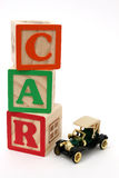 ABC Blocks and Black Antique Car Royalty Free Stock Photography