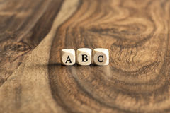 ABC blocks on wooden background Royalty Free Stock Images