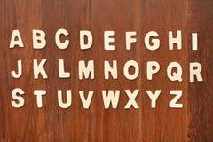 ABC de madera pone letras a alfabeto Imagenes de archivo