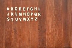 ABC de madera pone letras a alfabeto Foto de archivo