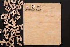 ABC en el tablero de madera, espacio de la copia Imagen de archivo libre de regalías