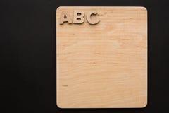 ABC en el tablero de madera, espacio de la copia Fotos de archivo