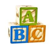 ABC en letras de molde de madera Imágenes de archivo libres de regalías