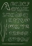 abc - Engelskt alfabet som är skriftligt på en svart tavla Arkivfoton
