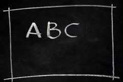 ABC escrito en la pizarra Imagen de archivo