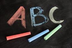 ABC escrito en tiza colorida Foto de archivo