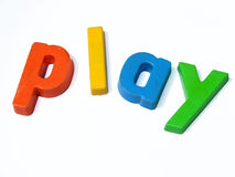 ABC fridge magnets spell Play. Play is spelt out in colourful children's ABC-123 magnets stock photos