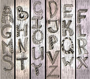 ABC, hand drawn alphabet over wood texture. Beautiful illustration Stock Photos
