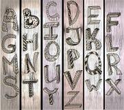 ABC, Hand gezeichnetes Alphabet über hölzerner Beschaffenheit Stockfotos
