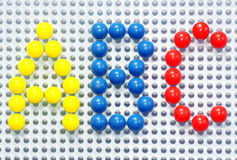 ABC i färgrika plastic stift Royaltyfria Bilder