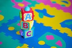 abc kuber, leksaker Arkivbild
