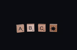 ABC. Learning the alphabet the first letter of the ABS on a dark background cubes Royalty Free Stock Image