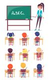 ABC Lesson in Primary School. Children Sit at Desk. And study alphabet at the lesson, teacher stands near blackboard with pointer Stock Photo