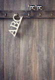 ABC Letters. ABC Alphabet letters hanging on hook with farmyard cow toys Stock Photos