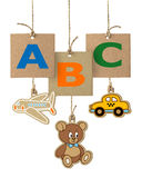 ABC letters on cardboard label. Alphabet logo isolated Stock Photos