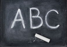 ABC letters and chalk on blackboard. Education concept. A B C letters and chalk on blackboard Stock Photography