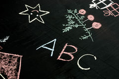 Abc letters chalk drawing on blackboard selective focus macro. Abc letters chalk drawing on blackboard background selective focus macro Stock Photos