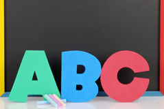 Abc letters chalkboard and chalk Stock Photo