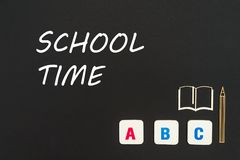 Abc letters and chipboard miniature on blackboard with text school time. Concept english school, text school time, abc letters, chipboard miniature book, pen on royalty free illustration