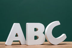 Abc letters in front of board Stock Images