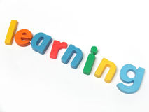ABC letters learning. ABC fridge magnet letters spell out the word learning stock photos