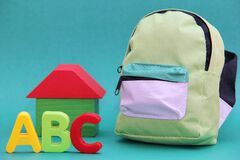 Free ABC - Letters Of The English Alphabet To The Will Of A Wooden House And A School Bag On A Green Background Royalty Free Stock Photo - 182453885