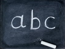 Abc letters and school stuff on blackboard Stock Image
