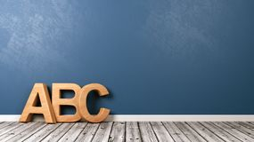 ABC Letters on Wooden Floor. Wooden ABC Letters Shape on Wooden Floor Against Blue Wall with Copyspace 3D Illustration Stock Image