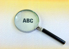 ABC and magnifying glass. Close up of ABC and magnifying glass Stock Image