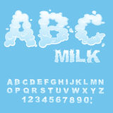 ABC Milk. white liquid letters. Fluid lettring. cream font of  w Stock Photography
