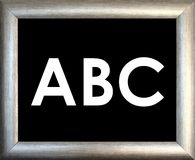abc och silverbildram på svart bakgrund Royaltyfria Foton